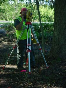 Brian Albright records prehistoric artifact locations with a total station