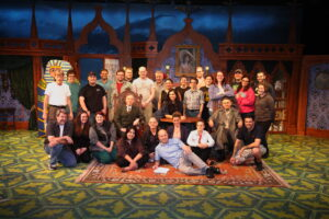 Ken Elliott (front row, center), surrounded by cast and crew.