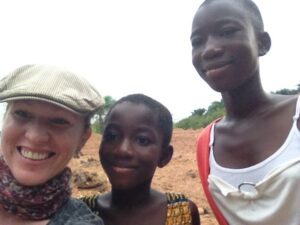Claudia Black (far left) and local residents in Ghana