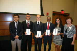 Business professors Sungsoo Kim (far left) and Carol Kaufman-Scarborough (far right) pose with the winners of the BizEd program for high school juniors: (l-r) Michael Kueny, Samuel Hacke, Evan White, and Veronica Tortella.
