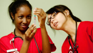 Rutgers School of Nursing-Camden students prepare a vaccination during a recent clinic.