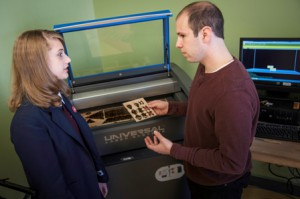 LEAP student Liz Ramos (left) consults with Rutgers-Camden student Steve Brownstein on a project.