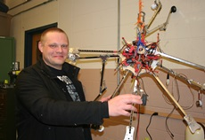 Scott Davis makes repairs to his octocopter.