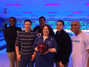 Rutgers-Camden business students Dan Gaffney, Melvin Nzali, Andrew Kaiser, Vince Tassone, and Kareem Sidani organized a bowling event to raise funds for the Boys and Girls Club of Camden County. Bernadette Shanahan, the executive director of the club, poses with the students.
