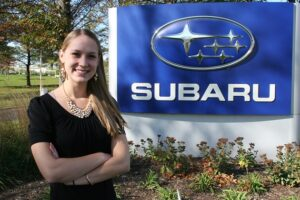 "Amelia Kaselaan helps market Subaru's ""Share the Love"" event as a part-time employee."