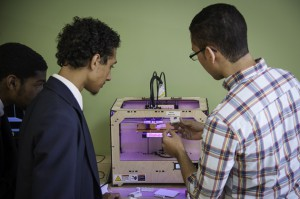 Rutgers-Camden students help LEAP Academy University Charter School students with 3D printing projects.
