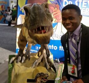 Antony Muthangya poses with a sharp-toothed friend at New York City's Toy Fair.