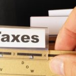 Checks and Balances: Public Policy Expert Michael Hayes Explains Candidates' Positions on Taxes