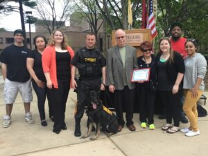 Members of the Criminal Justice organization present Ninja with his Kevlar vest.