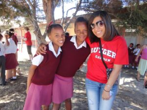 Neha Malkani with South African students during the 2012 trip.
