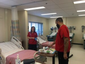 Wain and Poller prepare for a nursing simulation in a Rutgers-Camden lab.