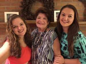Gerrie Suleta (center) with granddaughters Sarah Morris (left) and Colleen Morris (right).
