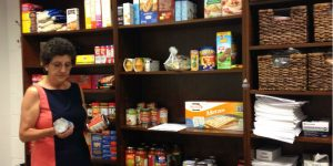 Maria Serra, director of Student Health Services checks items in the Raptor Pantry