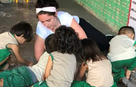 Erin Gullo with children at a daycare center in Brazil