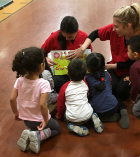 Rutgers School of Nursing‒Camden reading to Mercer County CYO preschool students