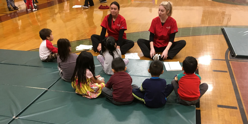 Rutgers School of Nursing‒Camden students teach yoga to preschool students