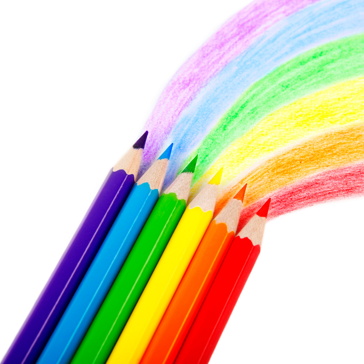 Colored pencils drawing a rainbow on a white background