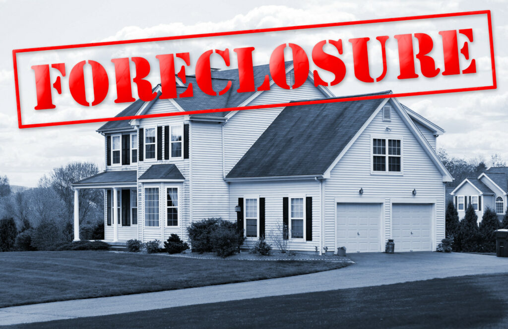 "Image of a house with ""forclosure"" written on it"