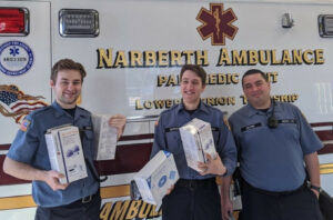 Paramedics from Narberth, Pa. holding boxes of medical supplies