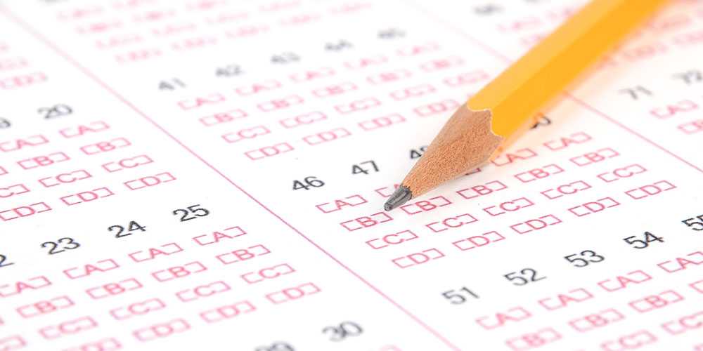 Closeup of a standardized test answer sheet and a pencil