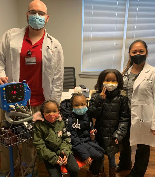 DNP student William Paynter, Nyla, Zuri, and Sage Wyatt, and DNP student Melanie Ransom