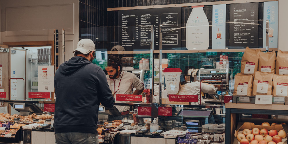 Customer ordering food at a cafe counter