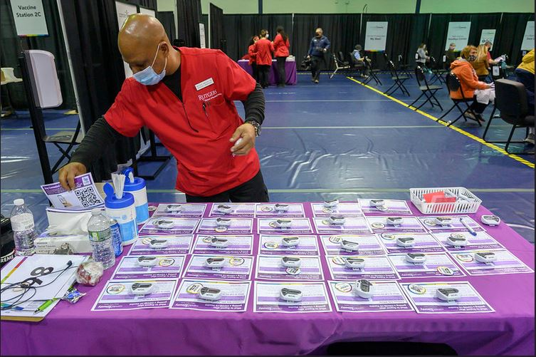 Michael Waters is among nearly 400 Rutgers School of Nursing‒Camden volunteers at the Camden County VaccMichael Waters is among nearly 400 Rutgers School of Nursing‒Camden student volunteers at the Camden County Vaccination Center in Blackwoodination Center in Blackwood