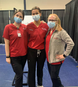 Leah Nagle (center) with classmates Chelsea Price (left), and Gabriella Castelina (right) volunteering at the Camden County Vaccination Center to provide COVID-19 vaccinations