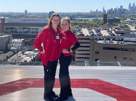 Rachel and Kelly Murphy on the helipad of Cooper University Hospital